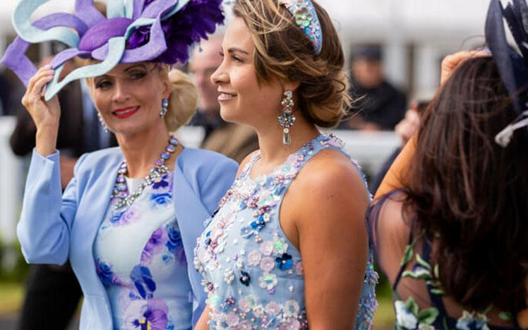 Ladies attending a raceday at Bath Racecourse.