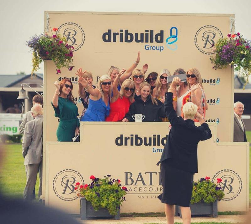 Group of ladies posing for a photo at Bath Racecourse.