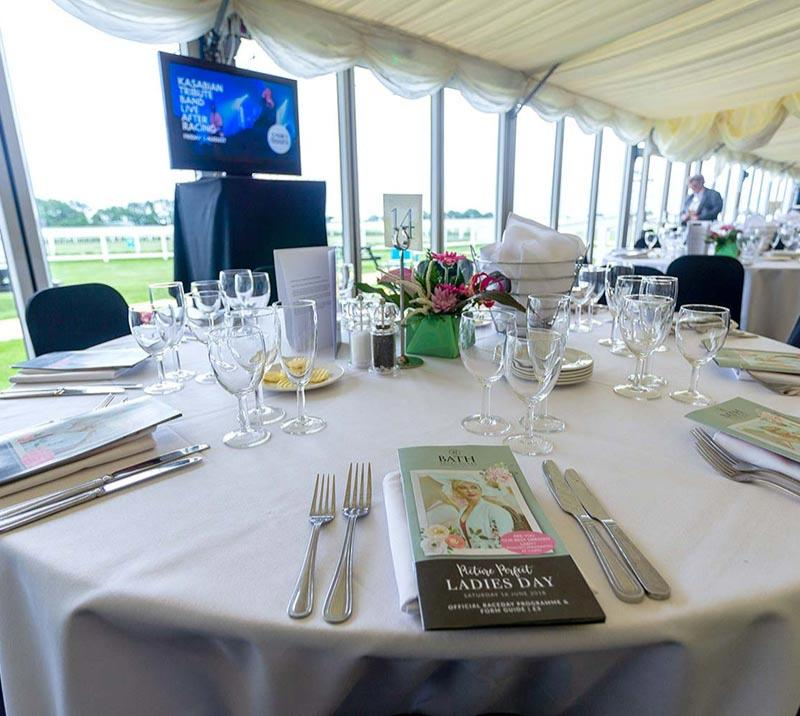 Close up on a table in a marquee restaurant at Bath Racecourse.