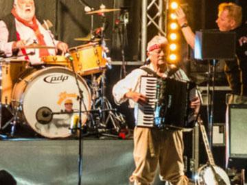 The Wurzels band playing on the stage.