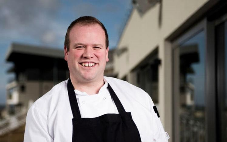 Jon Williams, the new head chef at Bath Racecourse posing for a photo.