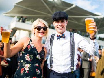 A man and a woman enjoying a summer evening at Bath races