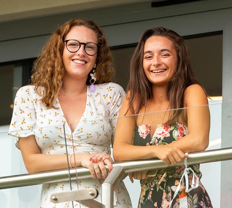 two women on the balcony at bath racecourse