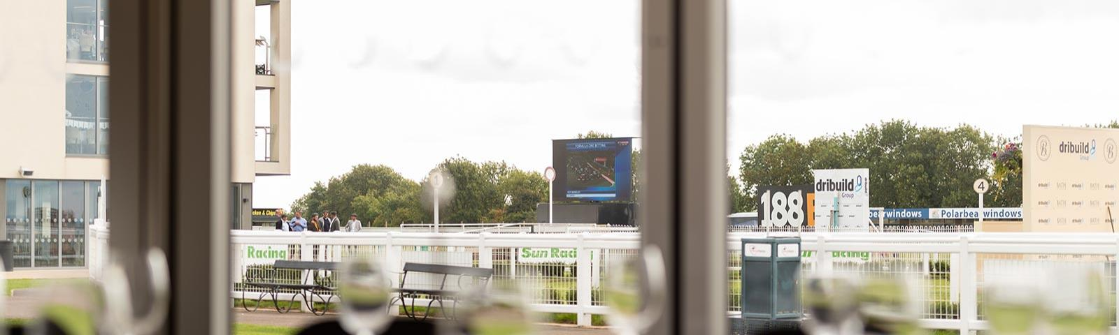 A view out into the parade ring from the Paddock Pavilion at Bath Racecourse.