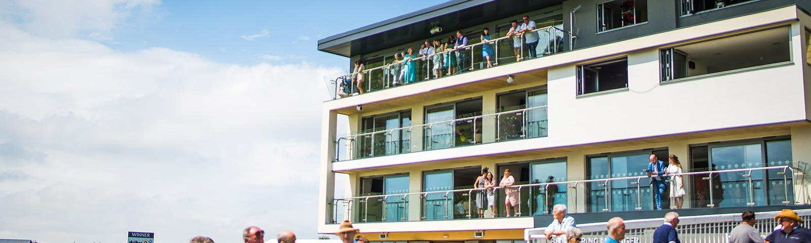Main building at Bath Racecourse hosting a number of restaurants and suites.
