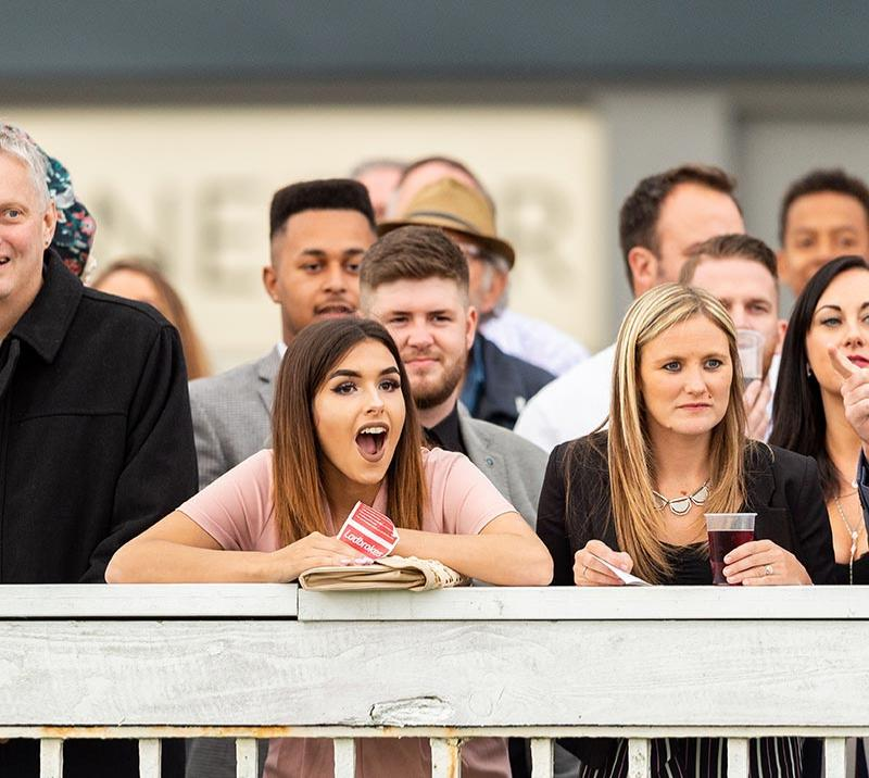 people watching the horse racing at bath racecourse