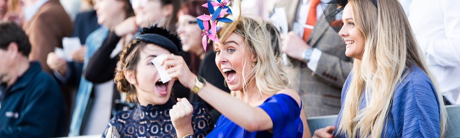 Two ladies cheering during a raceday at Bath Racecourse.