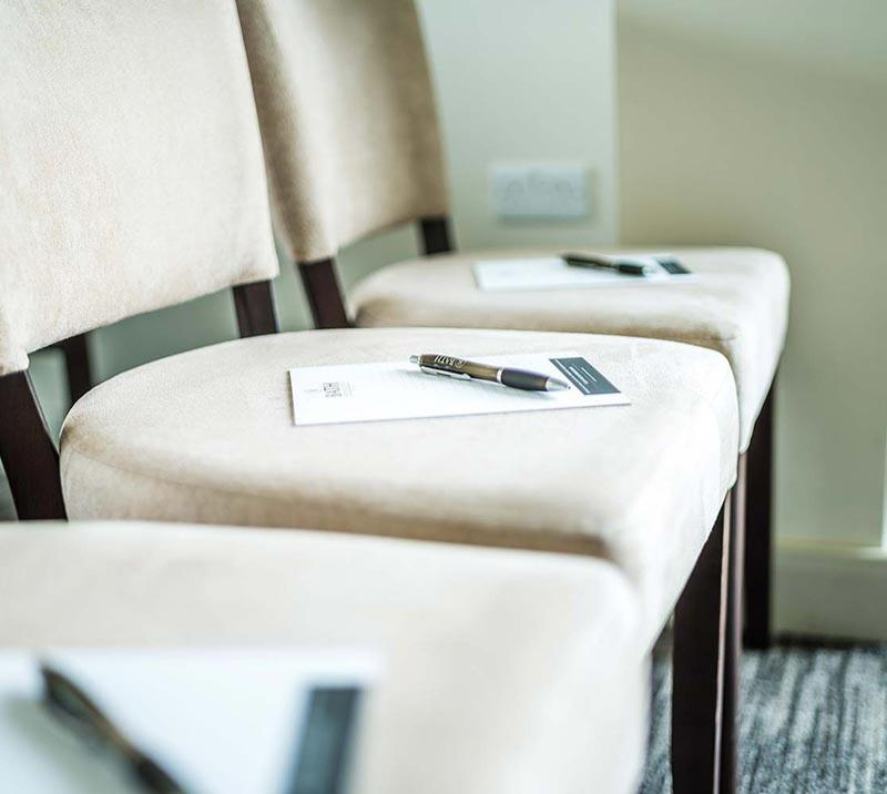 Close up of chairs in a meeting room.